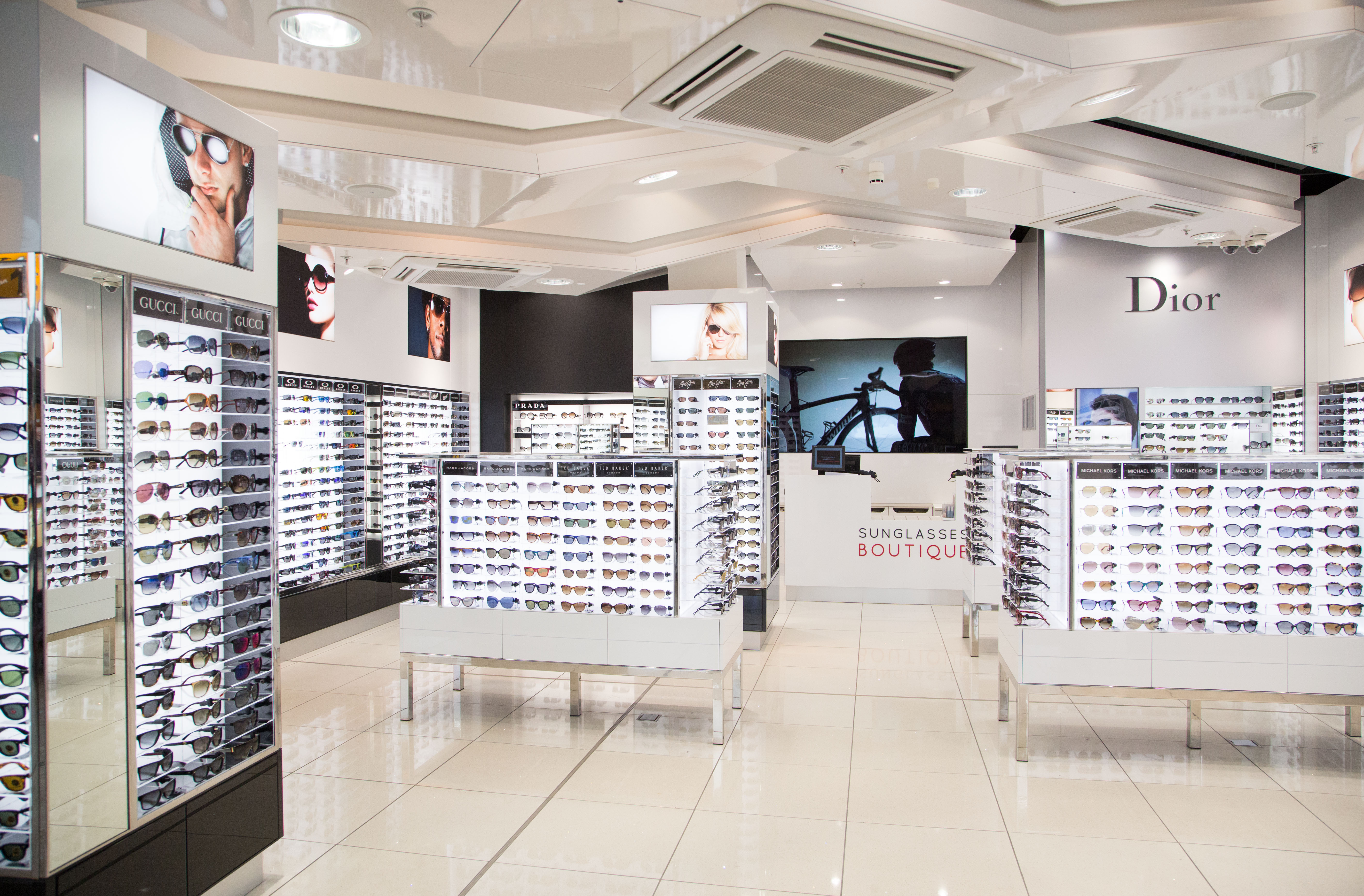 Wdfg opens first sunglasses boutique at heathrow t3 for Optical store designs interior