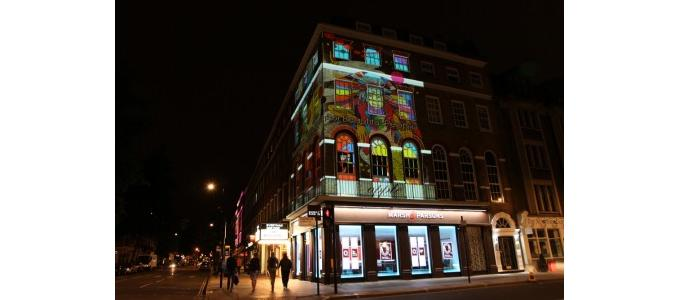 Beatles mural projection mapped on to its old Apple building in London