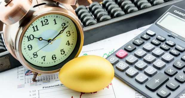 Investment clock calculator keyboard golden egg