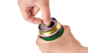 Man?s hand opening aluminum beer can