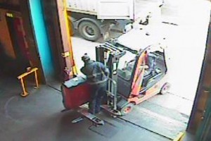 CCTV captures a worker balancing on the prongs on a forklift truck, shortly before he is injured in a fall
