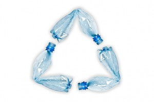 plastic-bottles-making-up-recycle-symbol-13733915