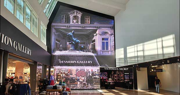 Ongekend Giant LED wall brings waterfall to airport store UW-99
